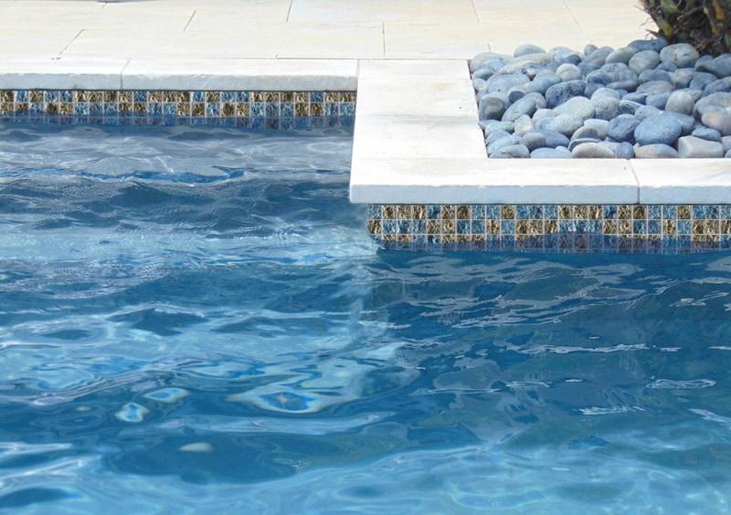 Burnished metals pool waterline