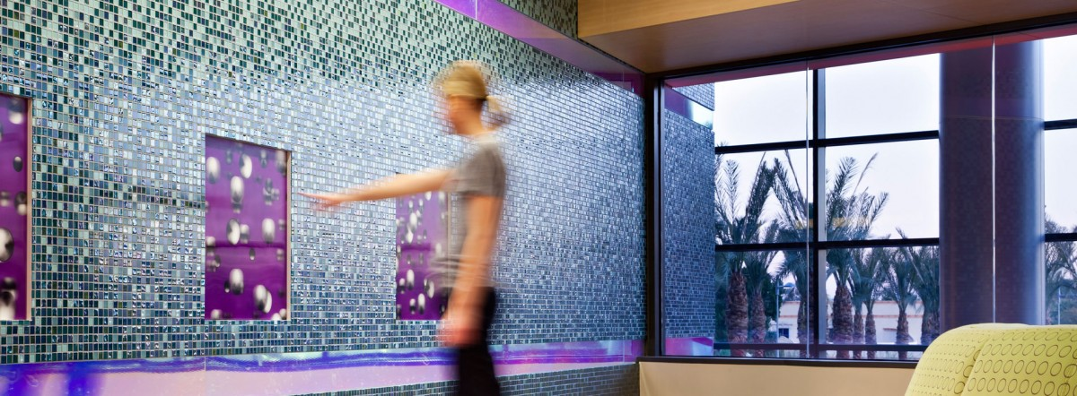 Phoenix Children's Hospital / HKS -  curated color palette of the wall glass tile wall mural adds an aesthetic and uplifting touch to the atmosphere of the facility.