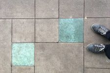 Skytrain Station 100% recycled glass pavers at Cambie St. and Broadway in Vancouver BC Canada